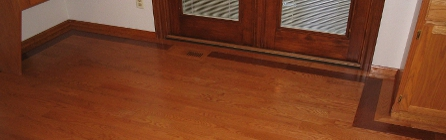 Prefinished hardwood flooring with a dark border